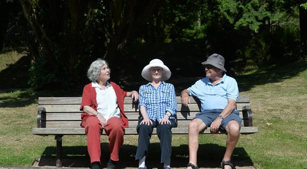 From L-R Hilary Robinson , Pat and Donald Nesbitt enjoying the warm weather at Castle gardens in Antrim on Wednesday, as the nice weather continues. Pic Pacemaker
