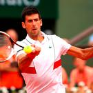 Big hit: Novak Djokovic at the French Open