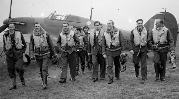 Pilots of No 303 (Polish) Squadron RAF with one of their Hawker Hurricanes