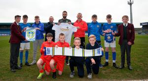 United together: John O'Kane of the Glenavon Academy joins Adam Underwood, Leeds United Academy Director, Philip McKinley of Lurgan Town and young players to celebrate the new partnership between the Lurgan Blues and Leeds United