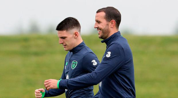 All smiles: Declan Rice and John O'Shea share a joke in training yesterday
