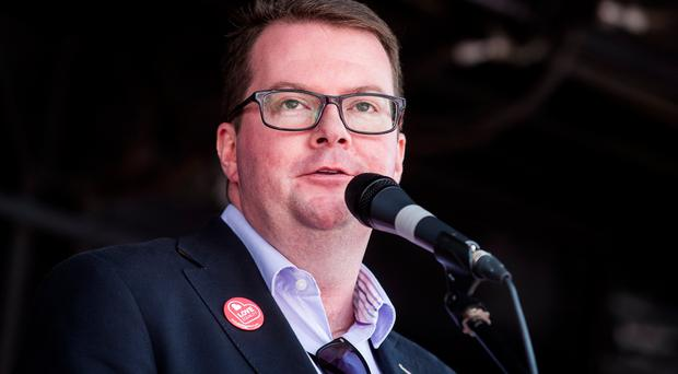 MP for St Helens North Conor McGinn speaking during Love Equality NI's march for marriage equality in Belfast on June 2.