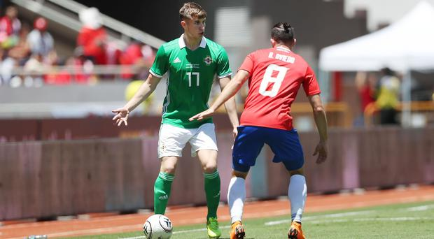 Northern Ireland's Paddy McNair up against Costa Rica's Bryan Oviedo on Sunday evening.