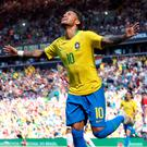 Brazil's Neymar celebrates scoring his side's first goal of the game during the International Friendly match at Anfield, Liverpool. PRESS ASSOCIATION Photo. Picture date: Sunday June 3, 2018. See PA story SOCCER Brazil. Photo credit should read: Nick Potts/PA Wire. RESTRICTIONS: Editorial use only, No commercial use without prior permission.