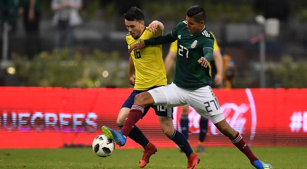 Scotland's Lewis Morgan (L) and Mexico's Hugo Ayala vie for the ball during their international friendly football match at the Azteca stadium in Mexico City, on June 2, 2018. / AFP PHOTO / YURI CORTEZYURI CORTEZ/AFP/Getty Images