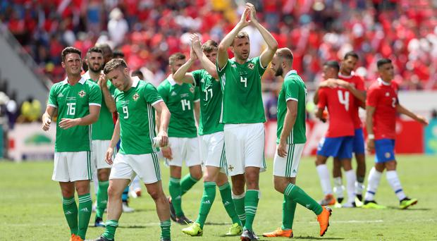 Warm applause: Gareth McAuley leads the way as Northern Ireland thank fans for their support amid soaring temperatures in Costa Rica