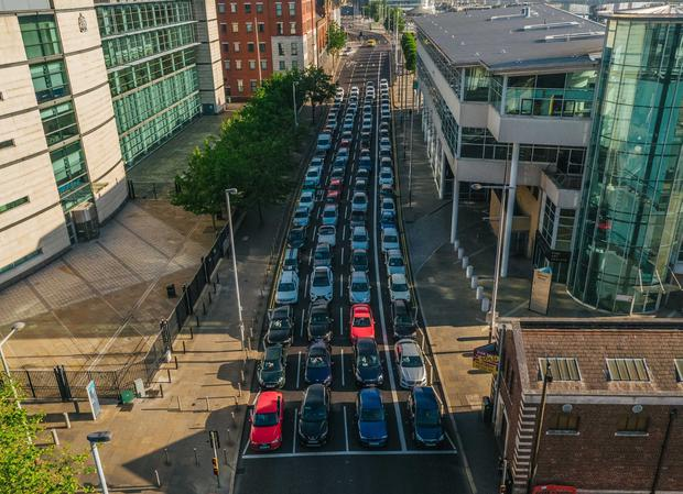 Drone footage captured on Oxford Street, Belfast showing the space required to transport 105 people by car (90 cars in total - during commuter times the average persons per car is 1.2 people). Pictures: Brian Morrison