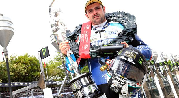 Michael Dunlop (Tyco BMW) celebrates winning Saturday's Superbike race.