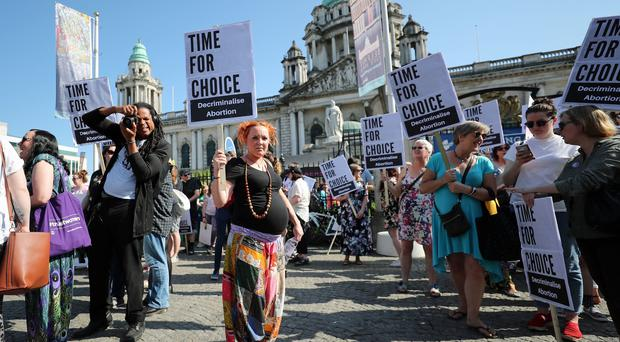 People attend a People Before Profit protest calling for the provision of abortion in Northern Ireland, at Belfast City Hall