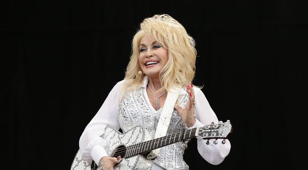 Dolly Parton will serve as singer-songwriter, co-star and executive producer on the Netflix programme (Yui Mok/PA)