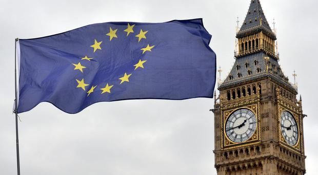 An EU flag flying in front of the Houses of Parliament (Victoria Jones/PA)