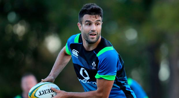 On the ball: Conor Murray during Ireland's training session on the Gold Coast yesterday
