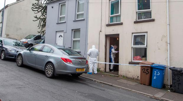 Forensic officers at the scene of the aggravated burglary in Newry