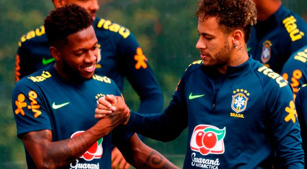Good pals: Fred and Brazil team-mate Neymar in training before the World Cup