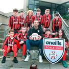 Quick draw: Brighton and Republic of Ireland ace Shane Duffy helps out at the launch event of the Foyle Cup last night