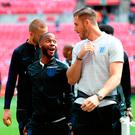 Key man: Raheem Sterling jokes with Jack Butland at Wembley