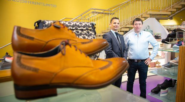 Danny Hughes from Danske Bank (left) with Peter McVeigh of Donaghy Shoes