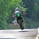 Light work: Michael Dunlop flies through Milntown on his way to victory in the Supertwins