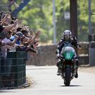 Light fantastic: Michael Dunlop takes the salute from TT crowds after his Lightweight race win yesterday