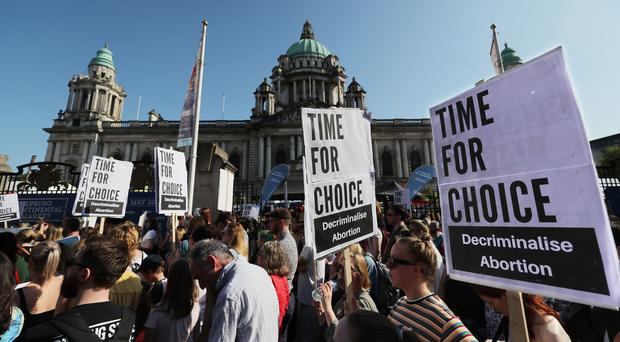 People attend a People Before Profit protest calling of for provision of Abortion in Northern Ireland (Niall Carson/PA)