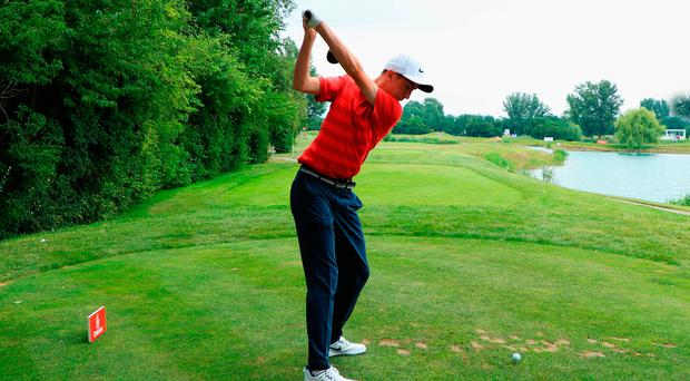 Driving lesson: Tom McKibbin tees off on the fifth hole in Austria