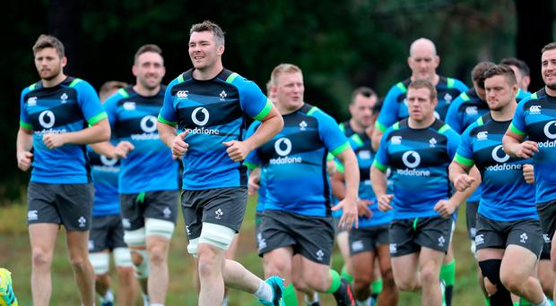 Up and running: Captain Peter O'Mahony leads Ireland's players during their training stint yesterday