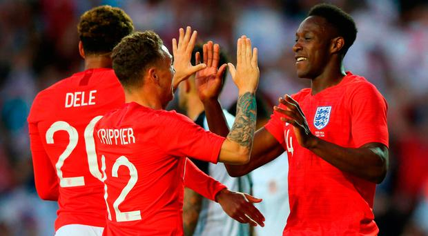 High fives: Danny Welbeck is hailed by Kieran Trippier after his late header