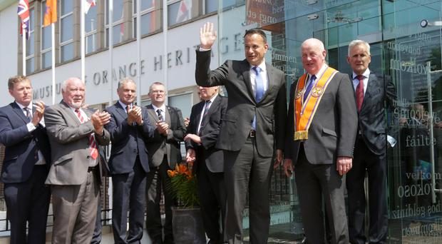 Taoiseach Leo Varadkar (third right) is applauded by members of the Orange Order (Laura Hutton/PA)