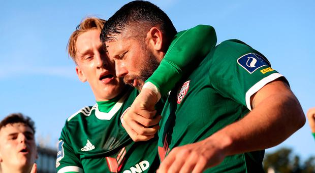 Derry delight: Rory Patterson celebrates with Ronan Curtis