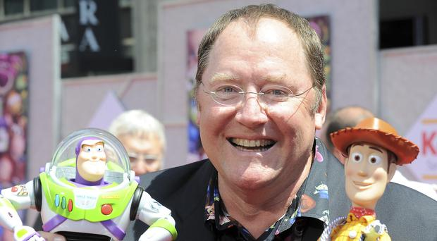 John Lasseter, the co-founder of Pixar Animation Studios and the Walt Disney Co.'s animation chief, will step down at the end of the year (Katy Winn/AP)