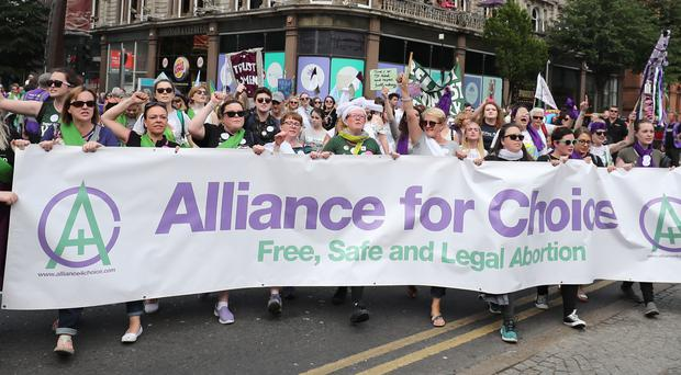 Alliance for Choice members take part in the Processions' artwork march (Niall Carson/PA)