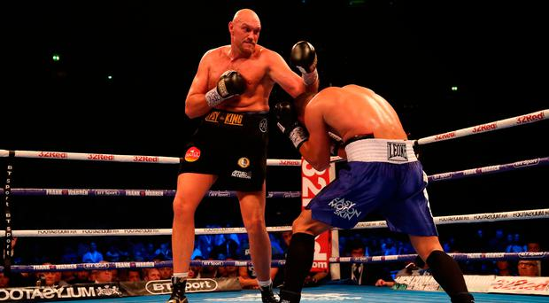 Comeback trail: Tyson Fury (left) finally dominates Sefer Seferi during their fight at the Manchester Arena on Saturday