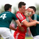 My ball: Derry's Shane McGuigan is put under pressure by Kildare's Mick O'Grady and Eoin Doyle at Owenbeg