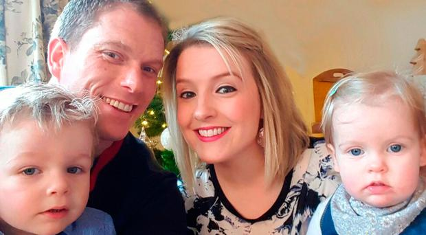 All smiles: Laura Lennox with her husband Gareth and (left) son James and daughter Lucy