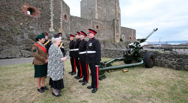 Mrs Joan Christie CVO, OBE, Her Majesty's Lord-Lieutenant for the County of Antrim, inspects the guns at Carrickfergus Castle in celebration of the Duke of Edinburgh's 97th birthday