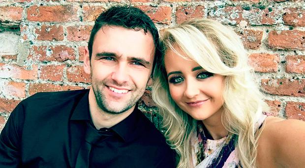 Racer William Dunlop with partner Janine