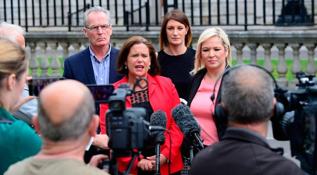 Sinn Fein president Mary Lou McDonald, deputy Michelle O'Neill and party colleagues outside the High Court in Belfast yesterday