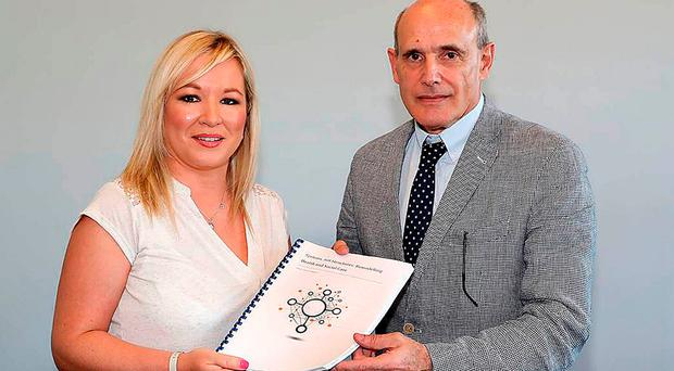 Previous Stormont health minister Michelle O'Neill and Professor Rafael Bengoa with the Bengoa Report in July 2016