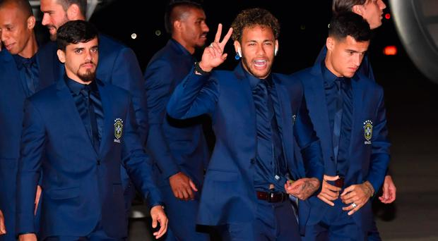 Big arrival Neymar gestures to the crowd as Brazil touch down in Russia