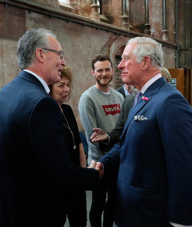 The Prince of Wales shakes hands with Sinn Fein MLA Gerry Kelly at Carlisle Memorial Church in Belfast where he is meeting the organisations involved in the regeneration of the building as a permanent home for the Ulster Orchestra. PRESS ASSOCIATION Photo. Picture date: Tuesday June 12, 2018. See PA story ROYAL Charles. Photo credit should read: Brian Lawless/PA Wire