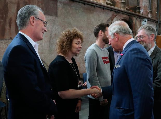 The Prince of Wales shakes hands with Sinn Fein MLA Caral Ni Chuilin as her colleague Gerry Kelly (left) looks on at Carlisle Memorial Church in Belfast, where Charles is meeting the organisations involved in the regeneration of the building as a permanent home for the Ulster Orchestra. (Brian Lawless/PA Wire)