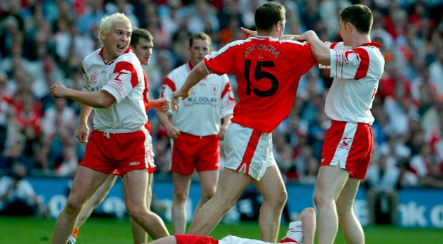 High tension: Armagh and Tyrone players clash in 2003