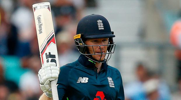 On form: Eoin Morgan celebrates his half-century