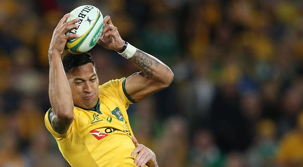 Going up: Israel Folau takes a high ball against Ireland in the first Test