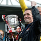 Just champion: Crues boss Stephen Baxter celebrates with league title