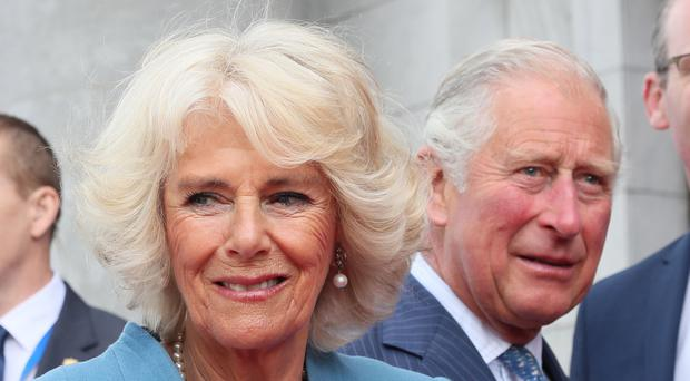 The Prince of Wales and the Duchess of Cornwall on a visit to Cork city (Brian Lawless/PA)
