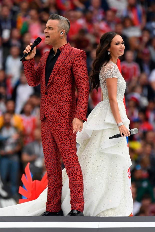 English singer Robbie Williams (L) and Russian soprano Aida Garifullina perform during the Opening Ceremony (AFP/Getty Images)