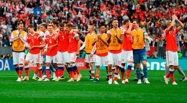 High five: the jubilant Russia team salute the home fans at the end