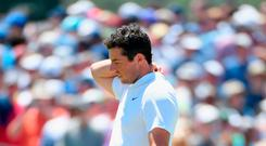 Rory McIlroy had to settle for a pat on the back from Shane Lowry after he soared to a 10-over 80 - his highest score in a major- in a US Open demolition derby on Long Island