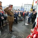 Colonel Rob Lyndsay, 38 Brigade lays a wreath. Photo by Kelvin Boyes / Press Eye.